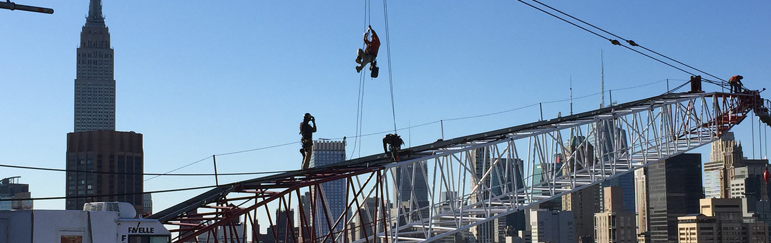 Ironworkers greasing topping lift